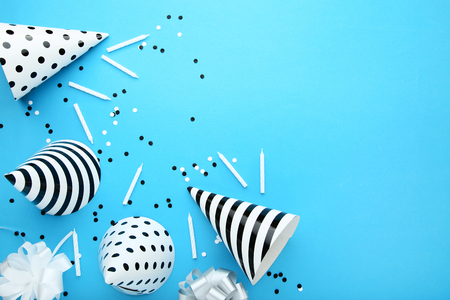 Birthday paper caps with candles on blue background Stock Photo