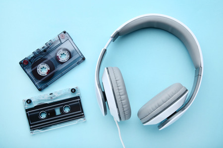 Headphones and cassette tapes on blue background