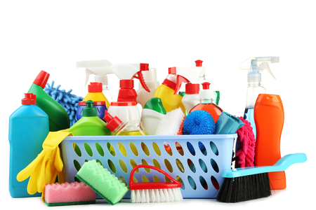 Bottles with detergent and cleaning tools on white background