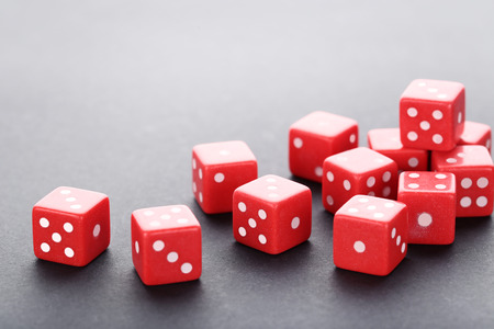 Red dice on grey background Stock Photo