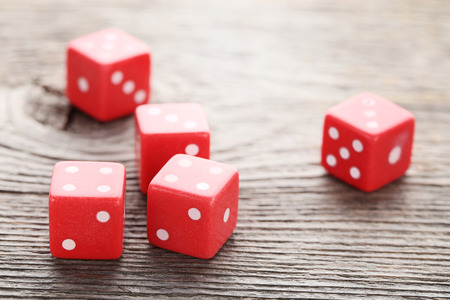 Red dice on grey wooden table Stock Photo