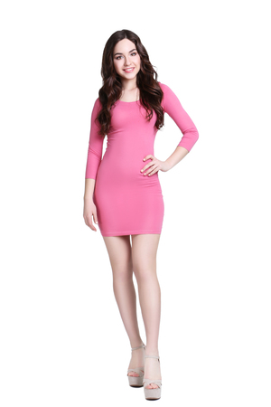 Young woman in pink dress on white background