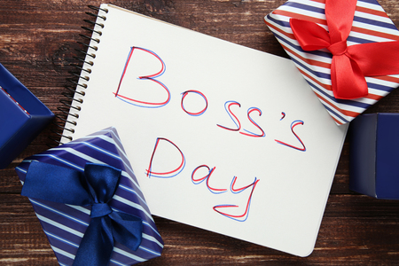 Inscription Boss Day in notebook with gift boxes Stock Photo