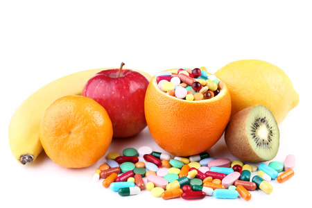 Ripe fruits and colorful pills on white background Standard-Bild - 110058544