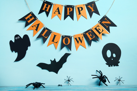 Paper halloween decorations with spiders on blue background Stock Photo