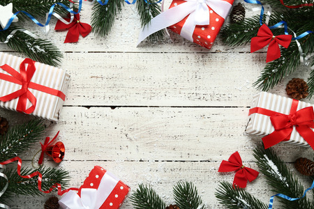 Christmas decorations with gift boxes on white wooden table Stock Photo