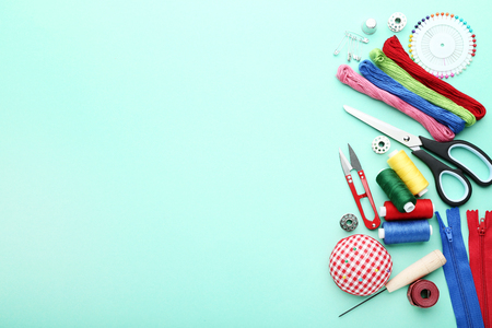 Sewing accessories on mint background