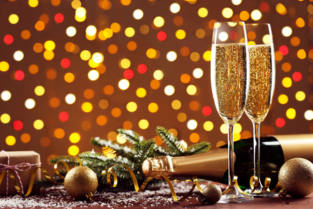 Champagne bottle with glasses, baubles and fir-tree branch on lights background