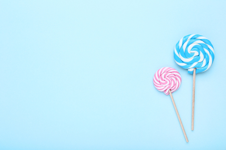 Colorful lollipops on blue background