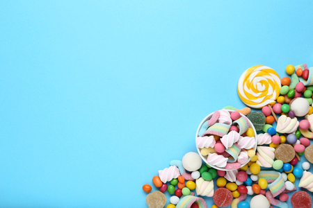 Sweet candies and lollipop on blue background