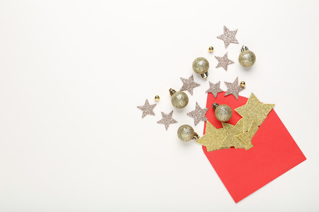 Red envelope with stars and baubles on white background