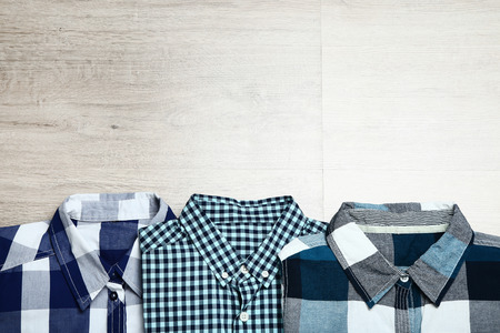 Folded shirts on wooden table