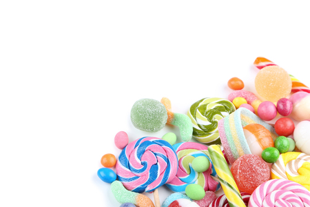 Sweet candies and lollipops on white background