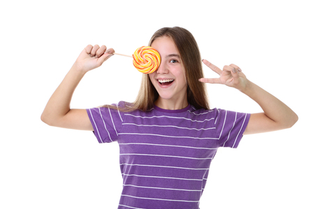 Young girl with lollipop on white background