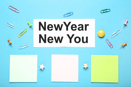 New year new you on sheet of paper with colorful clips