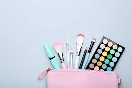 Different makeup cosmetics on grey background Imagens - 112578710