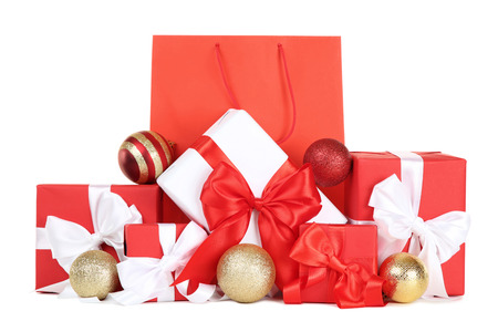Shopping bag with gift boxes and christmas baubles on white background Stock Photo