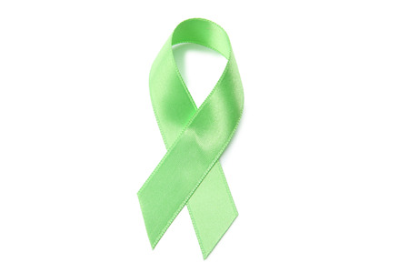Green ribbon on white background. Medical concept