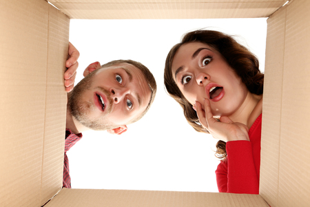 Young man and woman looking inside the box