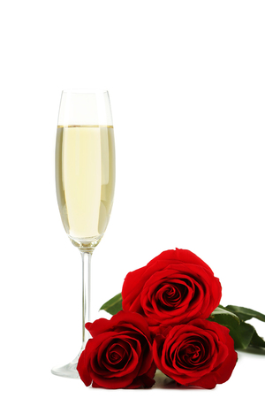 Champagne glass with red roses isolated on white background Banco de Imagens