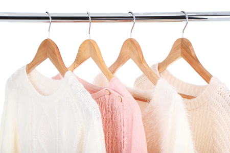 Clothes hanging on wooden hanger