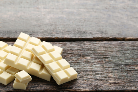 White chocolate bars on grey wooden table