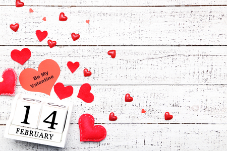 Red hearts with wooden calendar on white table Archivio Fotografico
