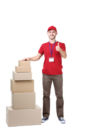 Delivery man with cardboard boxes on white background