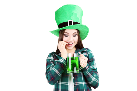 St. Patricks Day. Beautiful woman wearing green hat with beer on white background Stock Photo