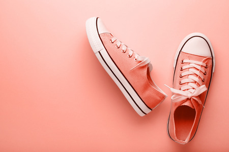 Fashion sneakers on living coral background