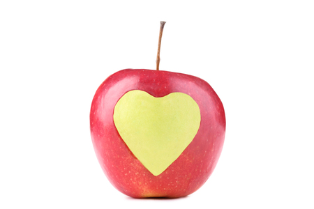 Red Apple With Cutout Heart Shape On White Background
