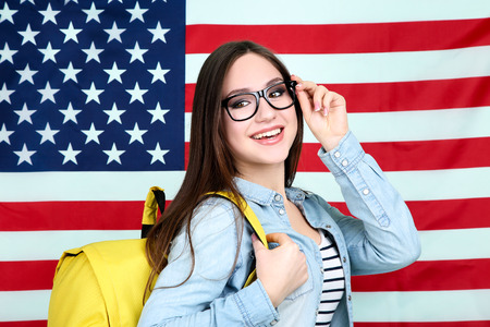 Young student with backpack on American flag background Stock Photo