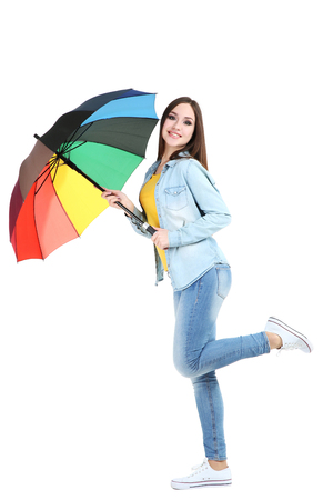 Young girl with colorful umbrella isolated on white background Stock Photo