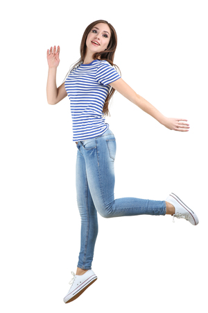 Jumping beautiful girl on white background