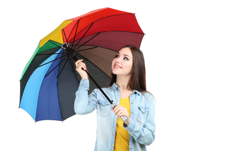 Young girl with colorful umbrella on white background