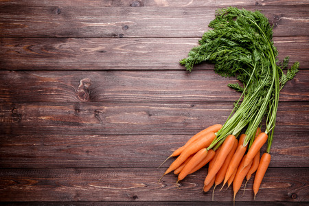 Fresh and sweet carrot on wooden background