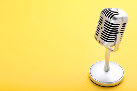 Vintage microphone on yellow background 写真素材