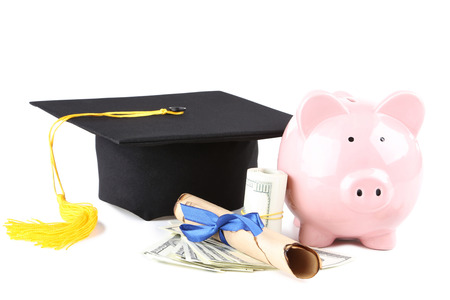 Piggybank with graduation cap, diploma and dollar banknotes isolated on white background