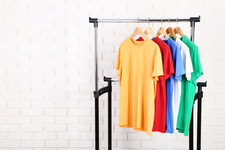 Fashion t-shirts hanging on brick wall background Stock fotó