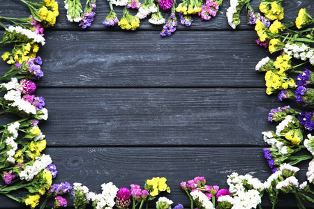 Spring flowers on black wooden table