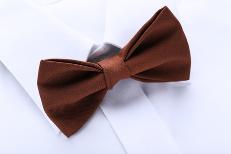 White shirt with brown bow tie Stock Photo