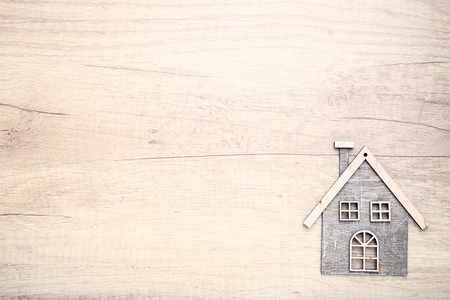 House model on wooden background