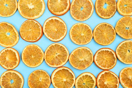 Dried orange fruits on blue background Stock Photo