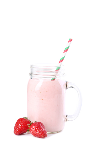 Strawberry smoothie in glass jar with straw on white background