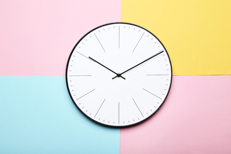 Round clock on colorful background