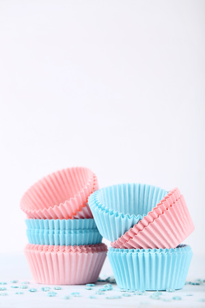 Colorful cupcake cases with sprinkles on white background Imagens