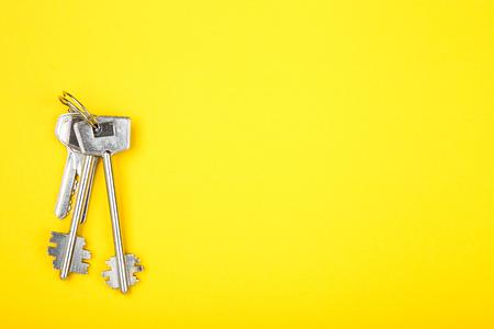 House keys on yellow background