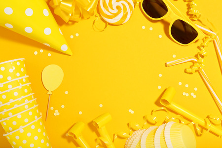 Birthday party decorations on yellow background. Minimalism concept