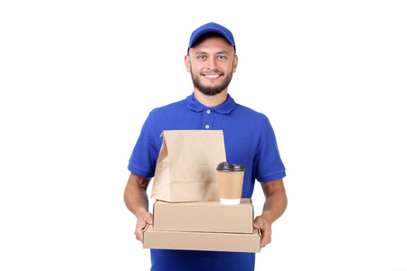 Delivery man with boxes, paper bag and cup on white background Banco de Imagens