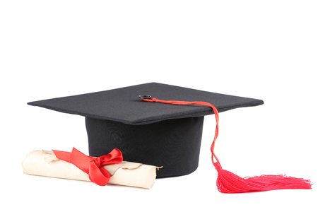 Graduation cap with diploma isolated on white background Banco de Imagens